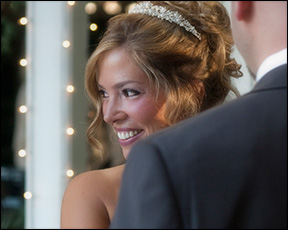 candid photojournalism of a bride glowing during their wedding ceremony