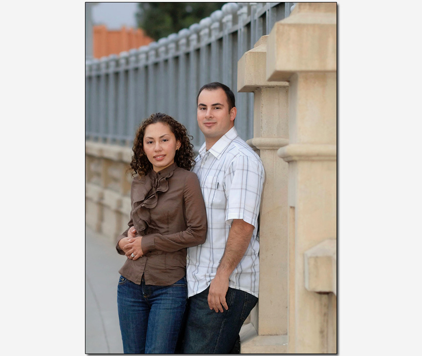 HIspanic-American couple on historic bridge