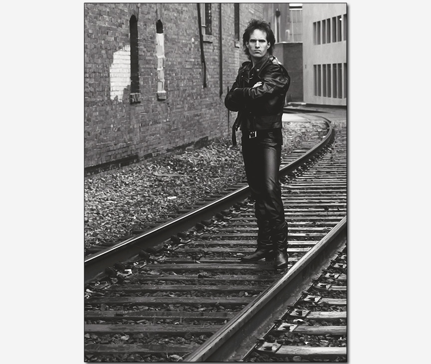 rock and roller with attitude on train tracks