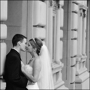 black and white image of bride and groom covered with bride's veil - testimonials photo